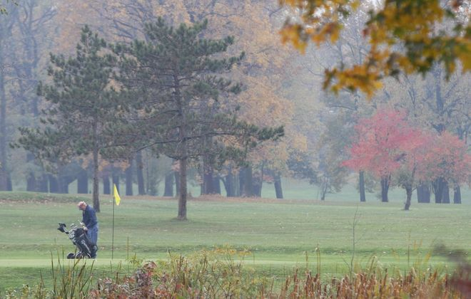 A golfer plays at the South Park golf course. (Mark Mulville / Buffalo News file photo)