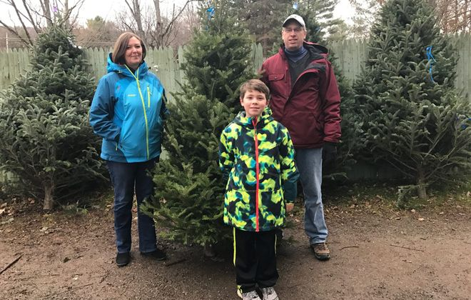 The Flynn family searched through muddy fields to find the perfect tree at Lindstrom's Farms in Hamburg. (Mary Friona-Celani/Special to The News)