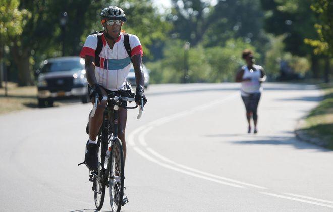 A bicyclist enjoys a ride in Delaware Park. (Sharon Cantillon/Buffalo News file photo)