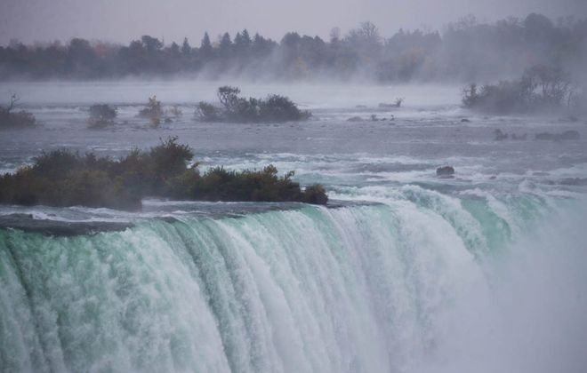 Mist rises from the Niagara River above the Horseshoe Falls in Niagara Falls, Ont. (Derek Gee/Buffalo News)