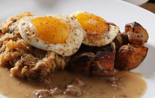 Toutant's chicken-fried steak has country gravy, taters and sunny side up eggs, during its Sunday brunch. (Sharon Cantillon/Buffalo News file photo)