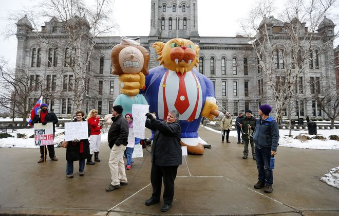 Protesters march, chant and protest against  Rep. Chris Collins outside County Hall on Franklin St. in Buffalo Saturday, March 18, 2017.       (Mark Mulville/Buffalo News)