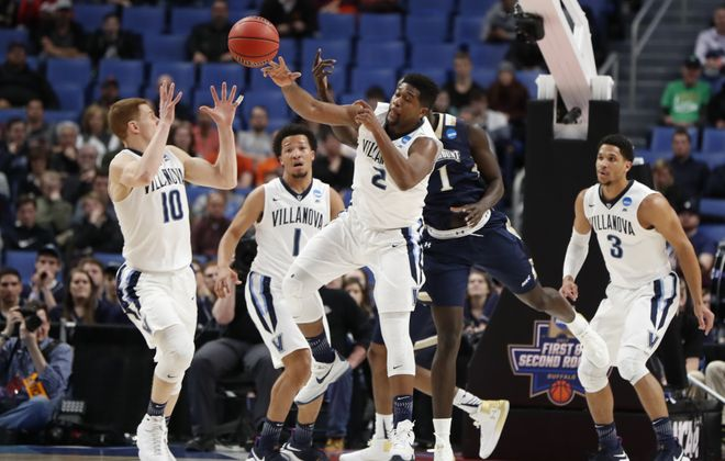 Villanova's Kris Jenkins grabs a rebound against Mount St. Mary's  during the first round of the 2017 NCAA Men's Basketball Tournament at KeyBank Center on Thursday, March 16, 2017. (Harry Scull Jr./Buffalo News)