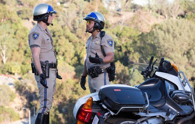 "Michael Pena and Dax Shepard in ""CHIPS."" (Warner Bros.)"