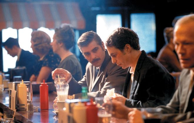 "George Clooney (left) and Sam Rockwell in ""Confessions of a Dangerous Mind."""