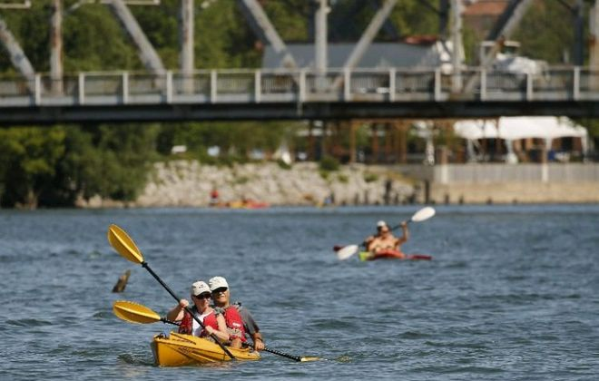 The Buffalo River attracts summer kayakers, but an analysis shows it remains one of the dirtiest rivers in New York. (Derek Gee/Buffalo News)