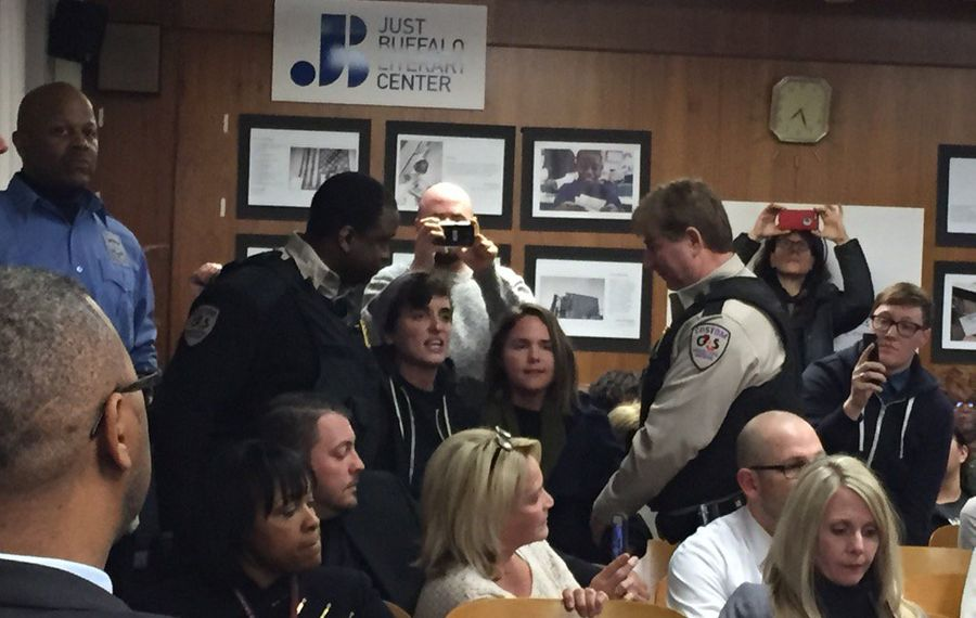 Security personnel try to remove protesters from Wednesday's School Board meeting. (Jay Rey/Buffalo News)