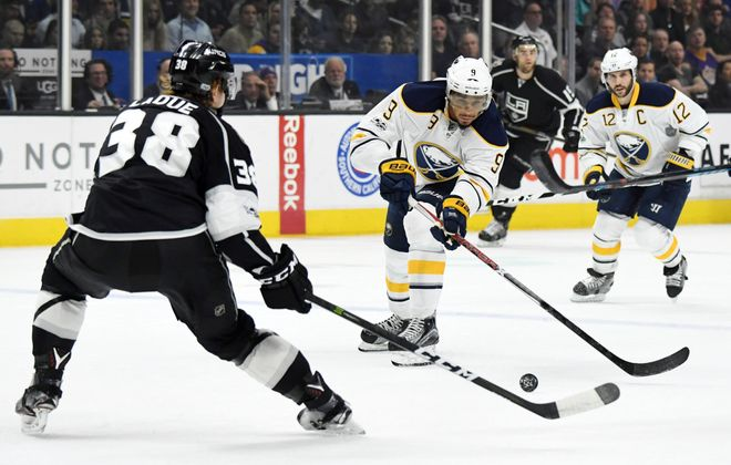Evander Kane shoots as Los Angeles defenseman Paul LaDue defends during the first period (USA Today Sports).
