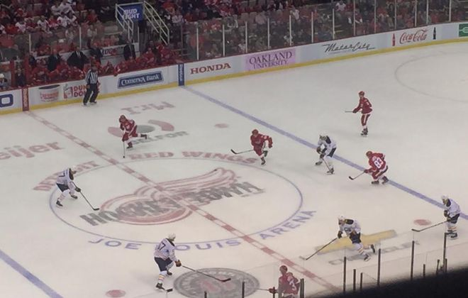 The Sabres and Red Wings battle in Buffalo's final game at Joe Louis Arena (Mike Harrington/Buffalo News).