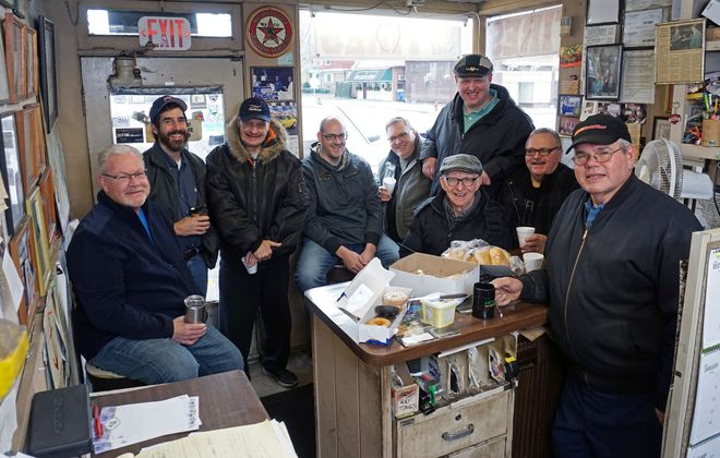 Some of the regulars gather on a typical Saturday morning at O'Neill's Auto Service. Pictured left to right: Tony Burvid, Pete Clancy, Mark Kowalczyk, Brett O'Neill, Bill O'Neill, Henry Demicke, Billy Scahall, Jimmy O'Neill, and Dick O'Neill. (Dave Jarosz)