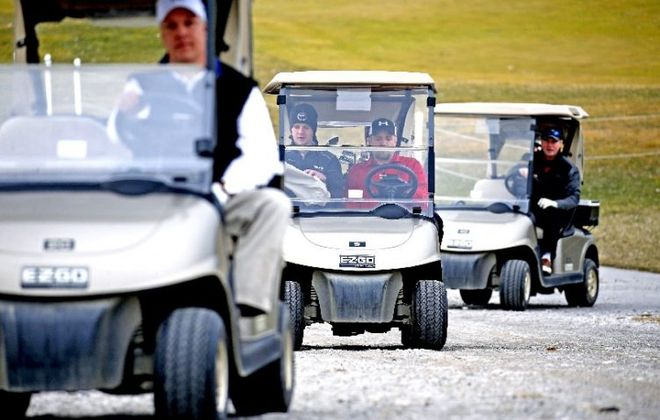 Golf cart traffic jam at Buffalo Tournament Club Golf Course on Genesee Street in Lancaster on a near 60-degree afternoon Feb. 21. (Robert Kirkham/Buffalo News)