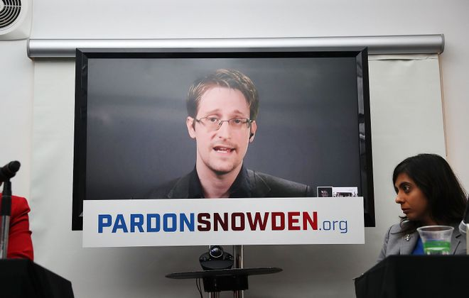 Edward Snowden speaks via video link at a 2016 news conference for the launch of a campaign calling for President Obama to pardon him (Spencer Platt/Getty Images)
