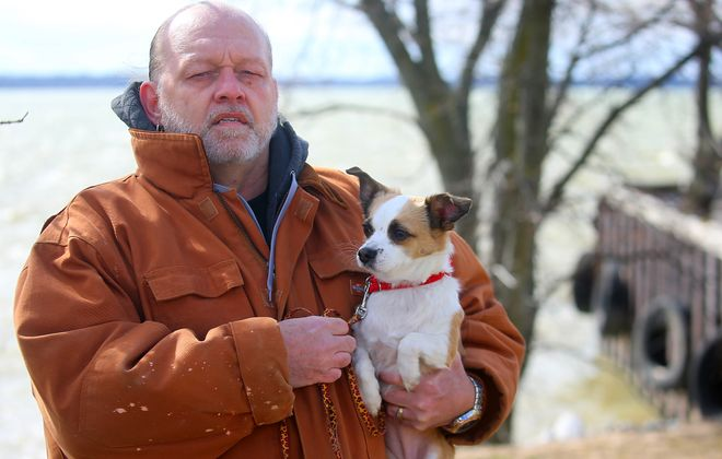 Randy Dullen jumped in the Niagara River by the Hooker Docks in Niagara Falls to save his dog, a 4-year-old Jack Russell terrier named Coco, on Feb. 23, 2017. He was able to push his dog out of the water. But Dullen was unable to climb out of the water himself. A  passerby saved his life after hearing his yells for help. Dullen and Coco returned to the docks on Thursday,  March 2, 2017. (John Hickey/Buffalo News)