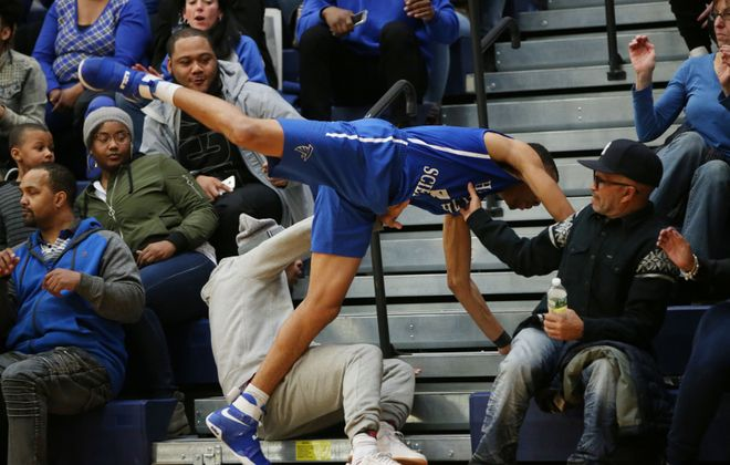 TayVion Nelson of Health Sciences goes all out to get to a loose ball during the Falcons' regional win over Mynderse. (Derek Gee/Buffalo News)