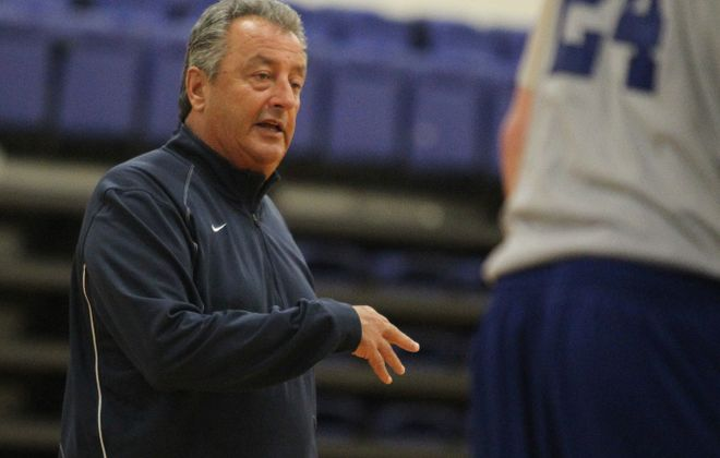 Don Silveri, pictured with Daemen in 2013, talks with his players during practice at the school in Amherst.  {Mark Mulville / Buffalo News}