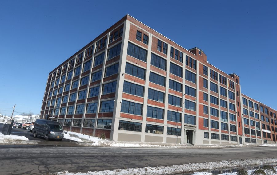 Savarino Companies used historic tax credits to renovate 500 Seneca, a former box factory converted into office space and apartments, with a restaurant, fitness center, spa and a new art gallery.   (John Hickey/Buffalo News)