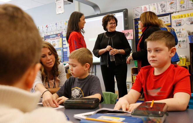 State Education Commissioner MaryEllen Elia, in background at center, tours Allendale Elementary School in West Seneca on Wednesday, March 30, 2016. West Seneca School District would see an increase of about 1.5 percent in state aid under Gov. Andrew Cuomo's proposed budget for 2017-18. (Derek Gee/Buffalo News)