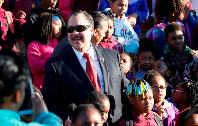 Superintendent Kriner Cash, in file photo with a group of students and faculty from Highgate Heights Elementary School on Walk to School Day last October.   (Derek Gee/Buffalo News)