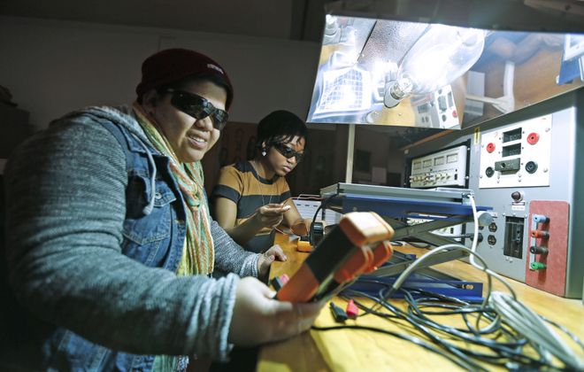 Students Alicia DiVita, left, and Chantel Hennings work at Erie Community College's electrical engineering training program. ECC is offering training programs geared toward the electrical and mechanical skills needed by many jobs at SolarCity and elsewhere. (Robert Kirkham/Buffalo News)