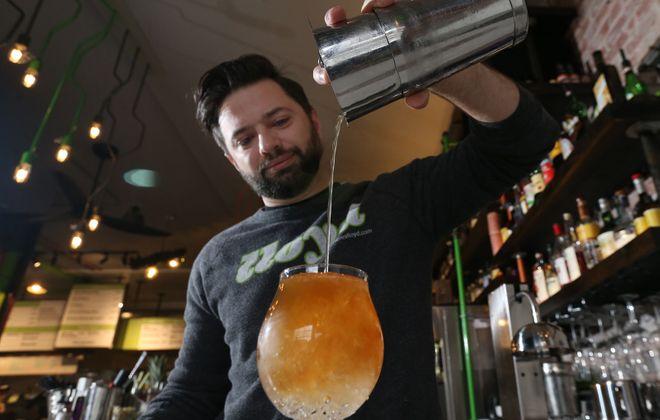 Lloyd Bar Director Yuri Polyachenko prepares the Nautical Disaster. (Sharon Cantillon/Buffalo News)