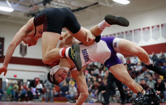 Hamburg's Jacob Smeader defeats Eric Bartnik from Cheektowaga in the 170-pound match during the ECIC wrestling championships at Starpoint High School Saturday. (Harry Scull Jr./Buffalo News)