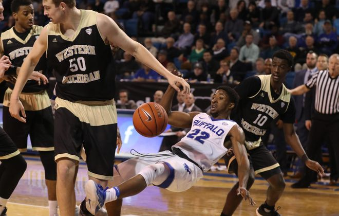 UB guard Dontay Caruthers is fouled by Western Michigan's Thomas Wilder (10) in a rough-and-tumble game won by the Bulls. (James P. McCoy/Buffalo News)