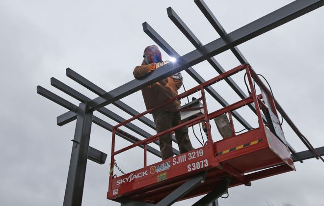 Welder Michael Hansen of Iron Workers Union Local 9 attaches a cross piece of steel on a pergola on the main entrance of the newly remodeled DoubleTree Hotel on Buffalo Avenue in Niagara Falls on Monday, Jan. 23, 2017. (Robert Kirkham/Buffalo News)
