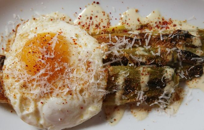 Wood-roasted leeks are made with mustard vinaigrette, a farm egg, breadcrumbs and shaved Parmesan at Grange Community Kitchen. (Sharon Cantillon/Buffalo News file photo)