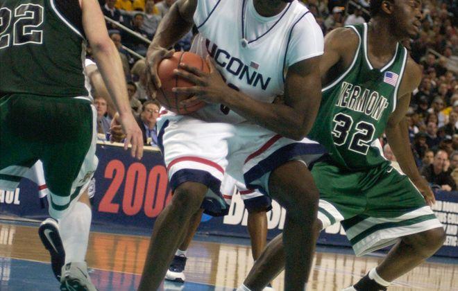UConn 's  Emeka Okafore protects a rebound as  University of Vermont  players fall back. (John Hickey/Buffalo News)