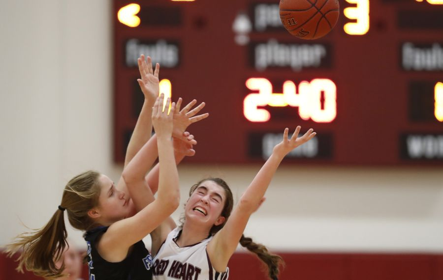 Sacred Heart's Siobhan Ryan and Frontier's Emily Kwiatkowski battle for a loose ball during second half action at Sacred Heart during the Sharks' victory. (Harry Scull Jr./Buffalo News)