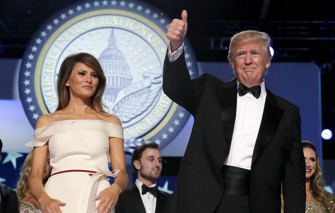 U.S. President Donald Trump and first lady Melania Trump thank guests during the inaugural Freedom Ball at the Washington Convention Center January 20, 2017 in Washington, DC. The ball is part of the celebrations following the inauguration of Pence and U.S. President Donald J. Trump.  (Getty Images)