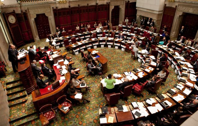 The State Legislature should reject an expanded prevailing wage law, which would harm this region. And the State Senate, shown above, should following the Assembly's lead and vote to change the date of the Buffalo School Board election. (Getty Images)