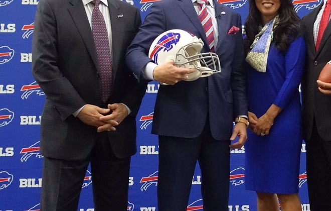 From left to right: Terry Pegula, Sean McDermott, Kim Pegula and nobody else. (John Hickey/Buffalo News)