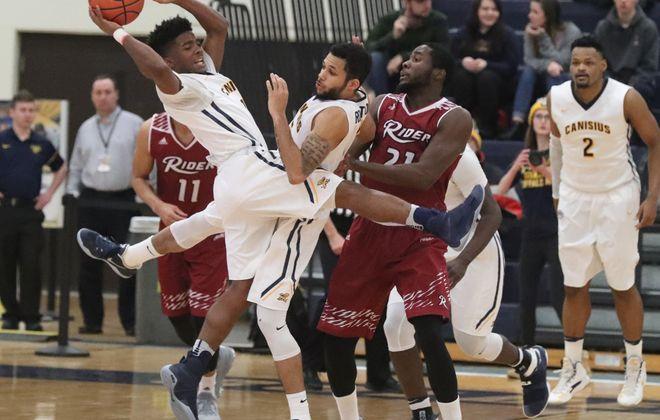 Canisius' Malik Johnson makes a pass. (James P. McCoy/Buffalo News)