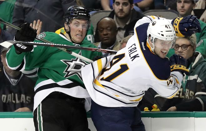Justin Falk and the Sabres couldn't get past Brett Ritchie and the Stars. (Getty Images)
