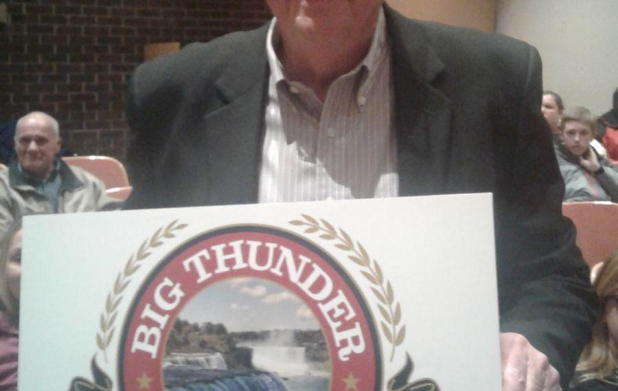 John Robinson, principal in Big Thunder Brewing Co., displays the company logo at Wheatfield Town Hall Jan. 23, 2017. (Thomas J. Prohaska / Buffalo News)