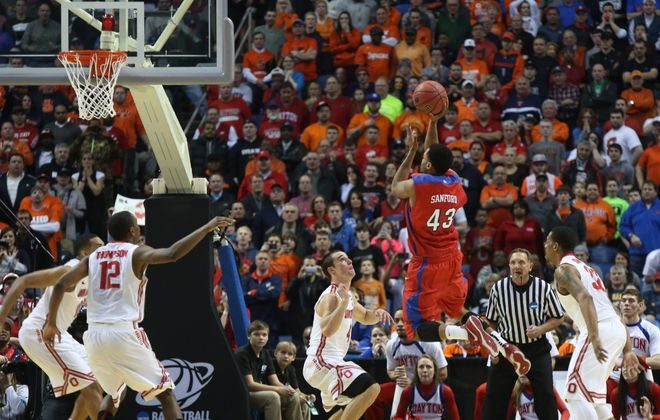 Dayton's Vee Sanford (43) hits the game-winning shot against Ohio State. (Robert Kirkham/Buffalo News)