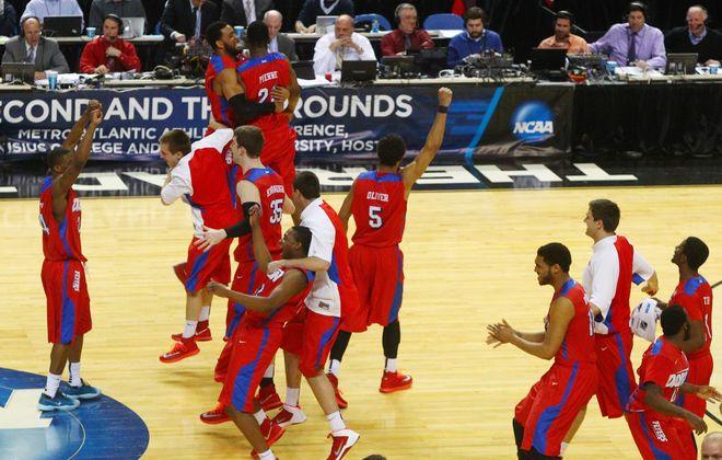 Dayton celebrates its 55-53 win over Syracuse. (John Hickey/Buffalo News)
