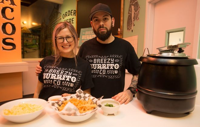 Briana Rose Hunter, left, has opened Breezy Burrito in EXPO Market. (Chuck Alaimo/Special to The News)