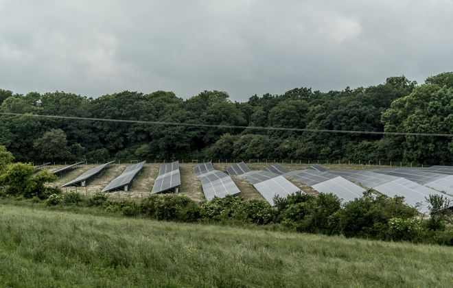 Rows of solar panels are spread over 25 acres on Nicholas Beatty's farm in Stoke Goldington, England. (Andrew Testa/The New York Times)