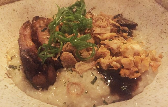 Congee, a rice porridge topped with pork belly and chicken, from Roost. (Caitlin Hartney/Special to The News)
