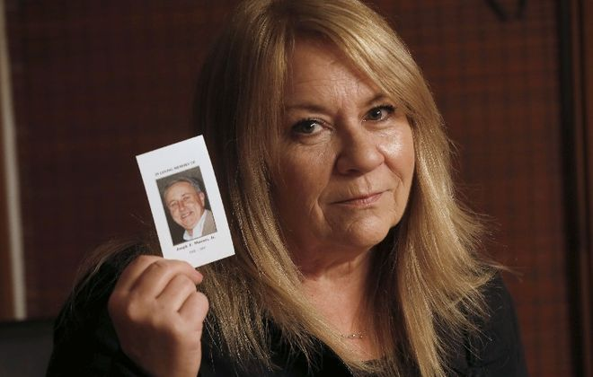Linda Muscato doesn't want revenge, just answers, about the 2001 arson at Rosa's that killed her husband, Joe (Robert Kirkham/Buffalo News)