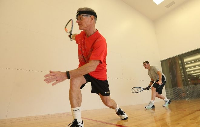 Raquetball may have hit its heyday a generation ago but several spots remain. Greg Maliken, left, of Amherst, who started playing racquetball when he was in college, plays a game at LA Fitness in Amherst with Dan Deschenes, of the Town of Tonawanda. (Sharon Cantillon/Buffalo News)