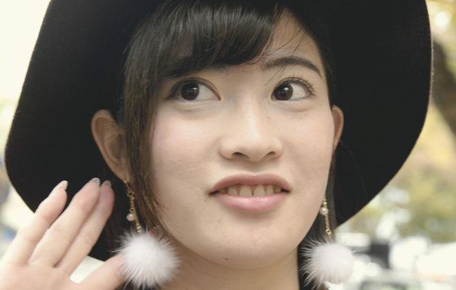 Faux fur around the world: A woman wears fluffy earrings in Tokyo. Photo from Japan News-Yomiuri