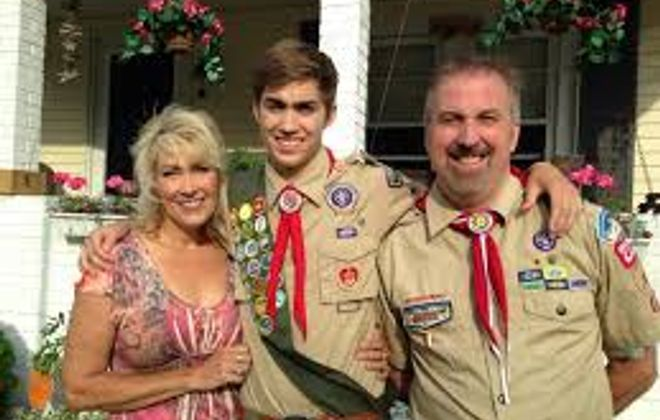 Jed Woomer, center, with his parents on June 10, 2014. Jed was an Eagle Scout and 2014 Tonawanda High School graduate who died on April 8, 2015 after cancer surgery