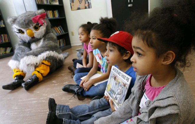 "The kids are sure to have a ball, and maybe meet mascot Reada Book Owl, on Saturday during ""Take Your Child to the Library Day"" across many of the 37 branches  of the Buffalo &  Library System. (Derek Gee/Buffalo News file photo)"