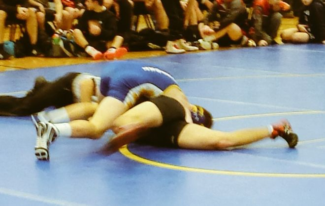 Steve Kapuscinski at 160 secures Lockport's 37-33 semifinal win over Lancaster during Saturday's Section VI Team Dual Meet Championships at Starpoint High School.