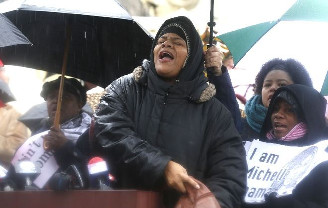 Poet Vonetta T. Rhodes-Osi speaks at a Niagara Square rally Tuesday demanding the ouster of School Board Member Carl P. Paladino after his racist remarks about President Obama and the first lady. (Robert Kirkham/Buffalo News)