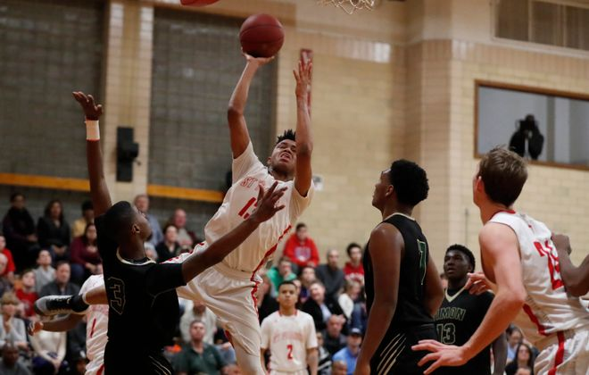 Roburt Welch goes up strong for two points during St. Francis' victory over Bishop Timon-St. Jude in Monsignor Martin boys basketball action Friday. (Harry Scull Jr./Buffalo News)
