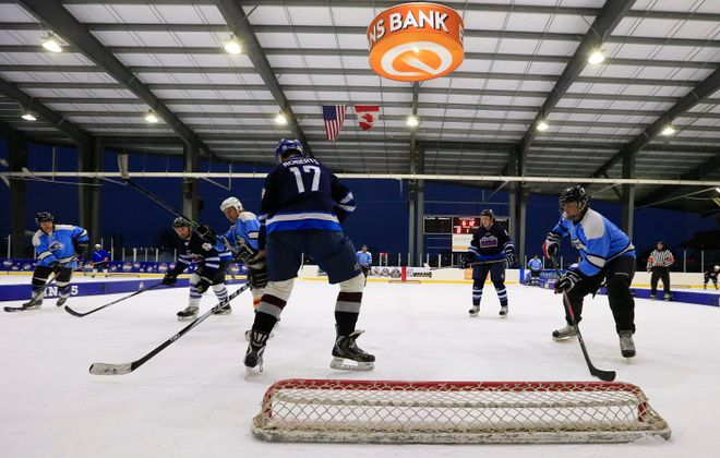 Cisco and the Ice Wolves play during the ninth annual Labatt Blue Buffalo pond hockey tournament in 2016. (Harry Scull Jr./Buffalo News file photo)